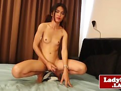 Tgirl spreads buttcheeks in front..