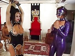 Shemale relative to latex BDSM orgy